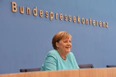 We can't go on like this: Angela Merkel says more must be done to tackle climate change after floods