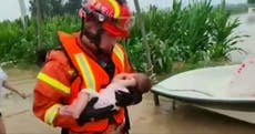 Baby rescued from China floods as deadly torrential rains continue