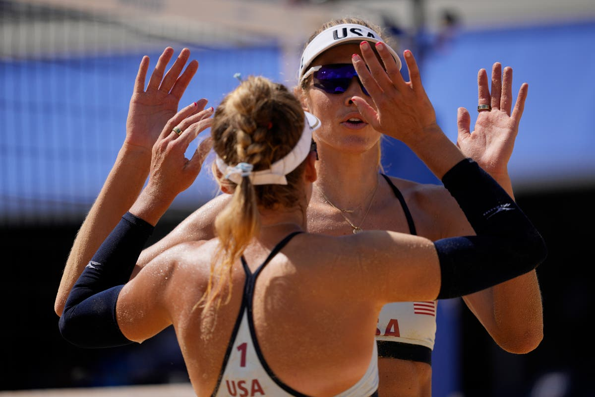Olympics Latest: US women open with beach volleyball win