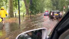 Heavy rains flood roads around London's Clapham Common
