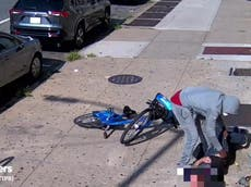 Mugger seen rifling through pockets of man beaten unconscious in violent New York attack