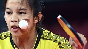 The ball hits Thailand's Orawan Paranang's face as she competes against Japan's Kasumi Ishikawa during her women's singles round 3 table tennis match at the Tokyo Metropolitan Gymnasium during the Tokyo 2020 Olympic Games