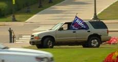 Woman waving Trump flag shouting she's a white woman drives onto Minnesota state capitol mall
