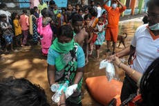 インドの洪水: 31 bodies stay buried in sludge as search called off at request of families