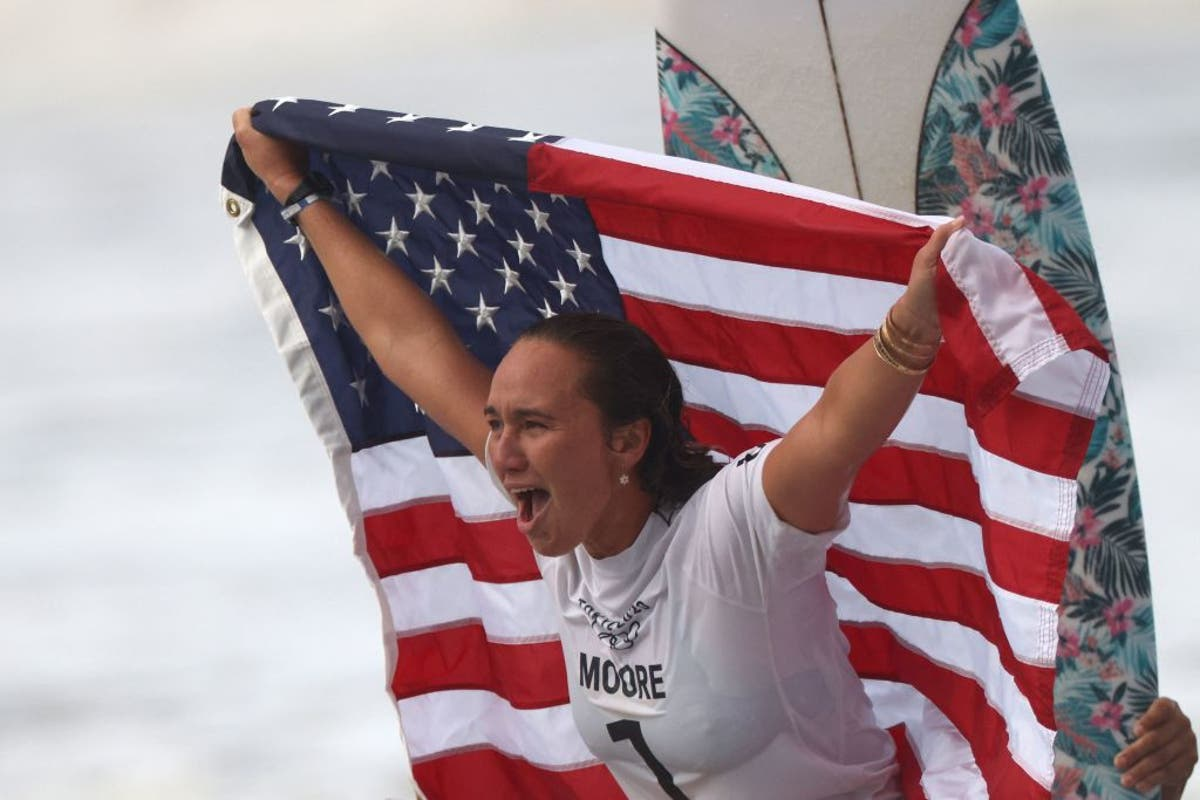 US surfer Carissa Moore wins Olympic Gold after becoming local favourite with speech in Japanese
