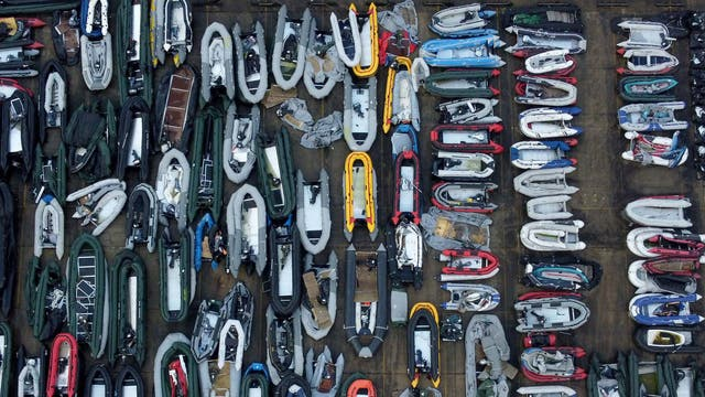 A view of one of two areas now being used at a warehouse facility in Dover, 肯特, for boats used by people thought to be migrants.