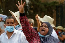 Tunisia's biggest political party calls for national dialogue after protests and ousting of PM