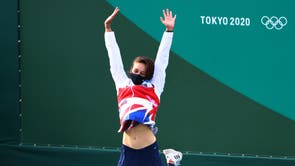 Great Britain's Mallory Franklin celebrates on the podium after she won silver in the women's C1 Canoe Slalom at Tokyo Olympics