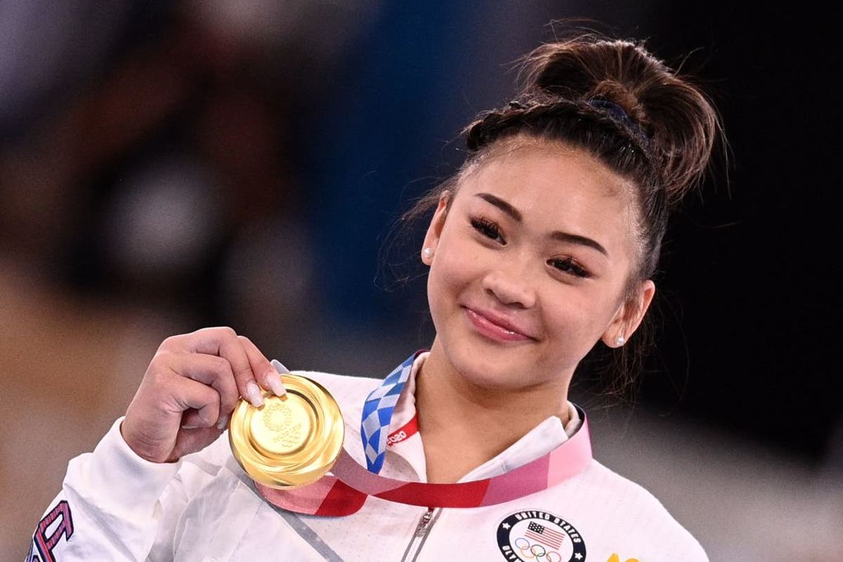 USA's new Olympic gold medallistSuni Lee couldn't afford a beam so her father built her one