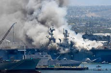 Sailor charged with starting $2.5 billion ship fire