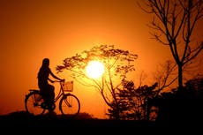 Bicycle riding volunteers deliver medicines in Indonesia