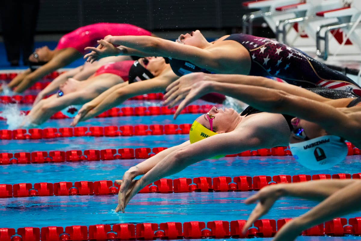 GLIMPSES: Olympic swimmers, reaching for victory