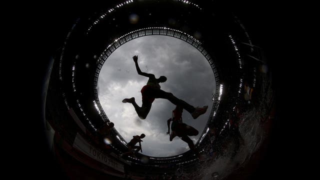 Athletes compete during the men's 3000m Steeplechase at the Tokyo Olympics