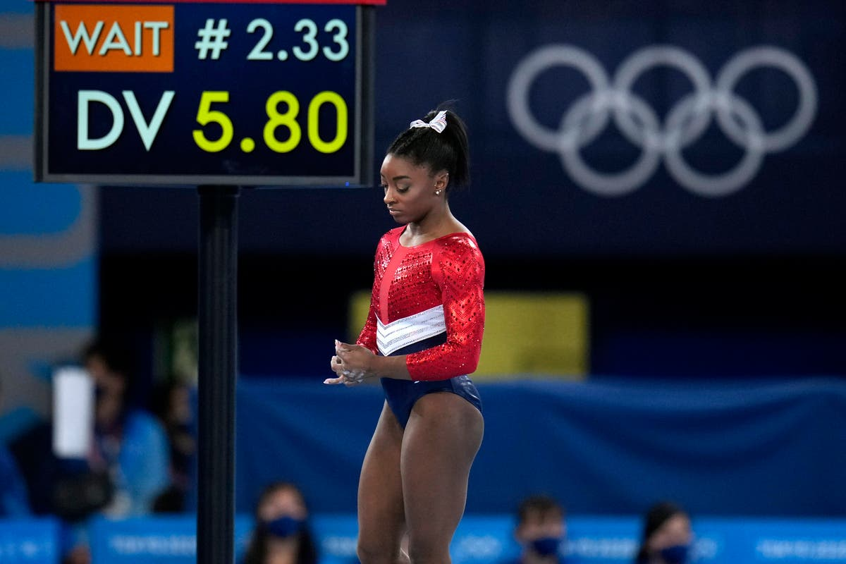 Biles out of vault and uneven bars; beam and floor possible