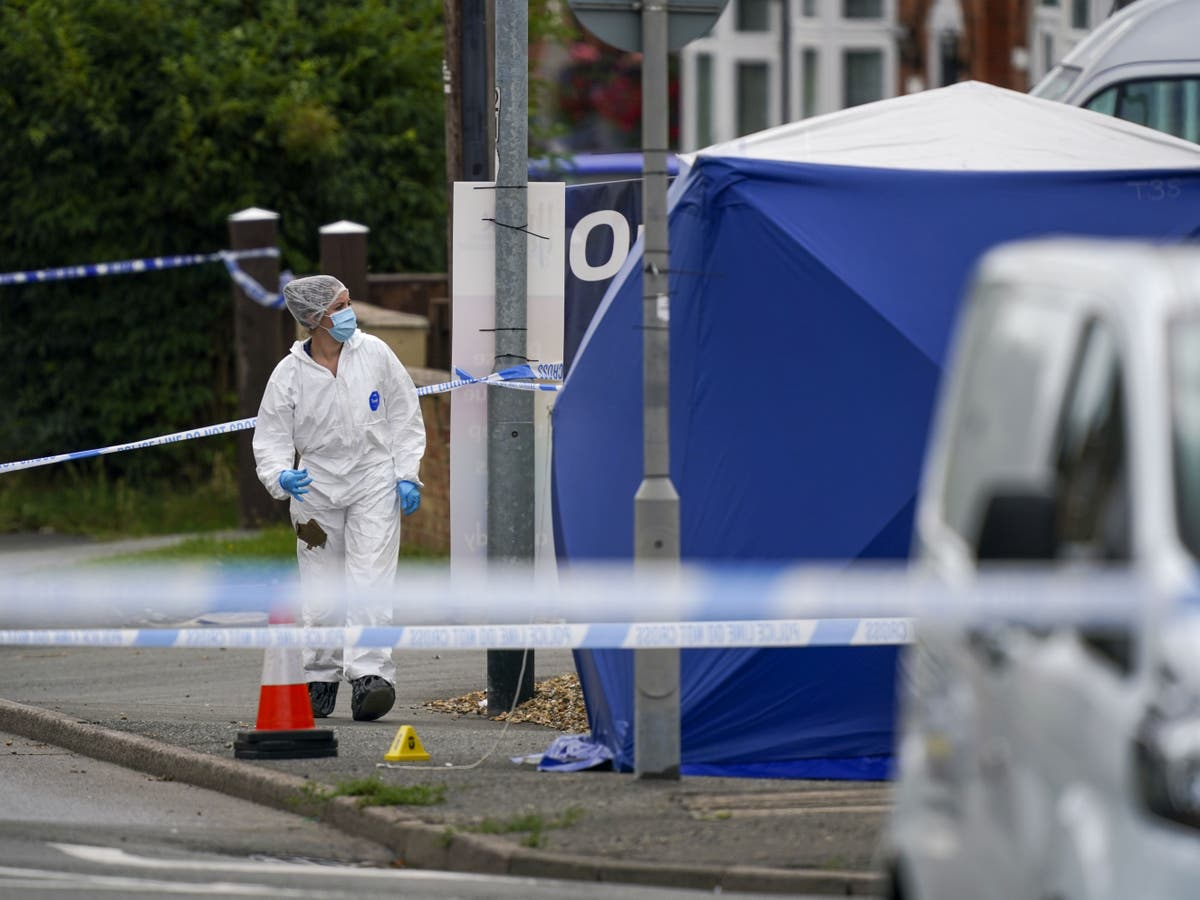 Police investigating death of man found 'surrounded by group'
