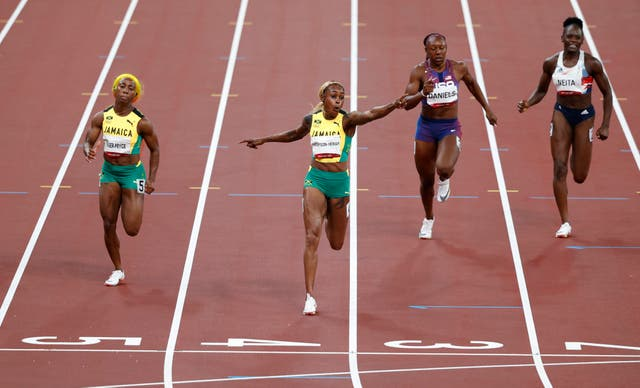 Elaine Thompson-Herah celebrates as she crosses the finish line to win the gold medal ahead of Jamaican teammate Shelly-Ann Fraser-Pryce in the women's 100m final at the Tokyo Olympic Games