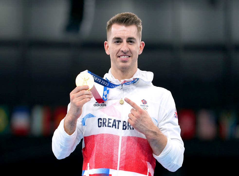 <p>Great Britain's Max Whitlock celebrates with his gold medal after winning the men's pommel horse final in Tokyo (Mike Egerton / PA)&ltbl/p>