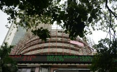 FTSE 100 edges higher as Sensex reclaims 53,000 and Wall Street tumbles on Covid fears