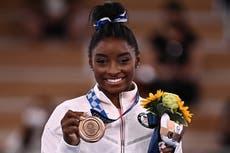 Simone Biles wins bronze on return to Tokyo Olympics as China's Guan Chenchen takes balance beam gold