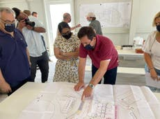Priti Patel visits 'inhumane' Greek asylum reception centre