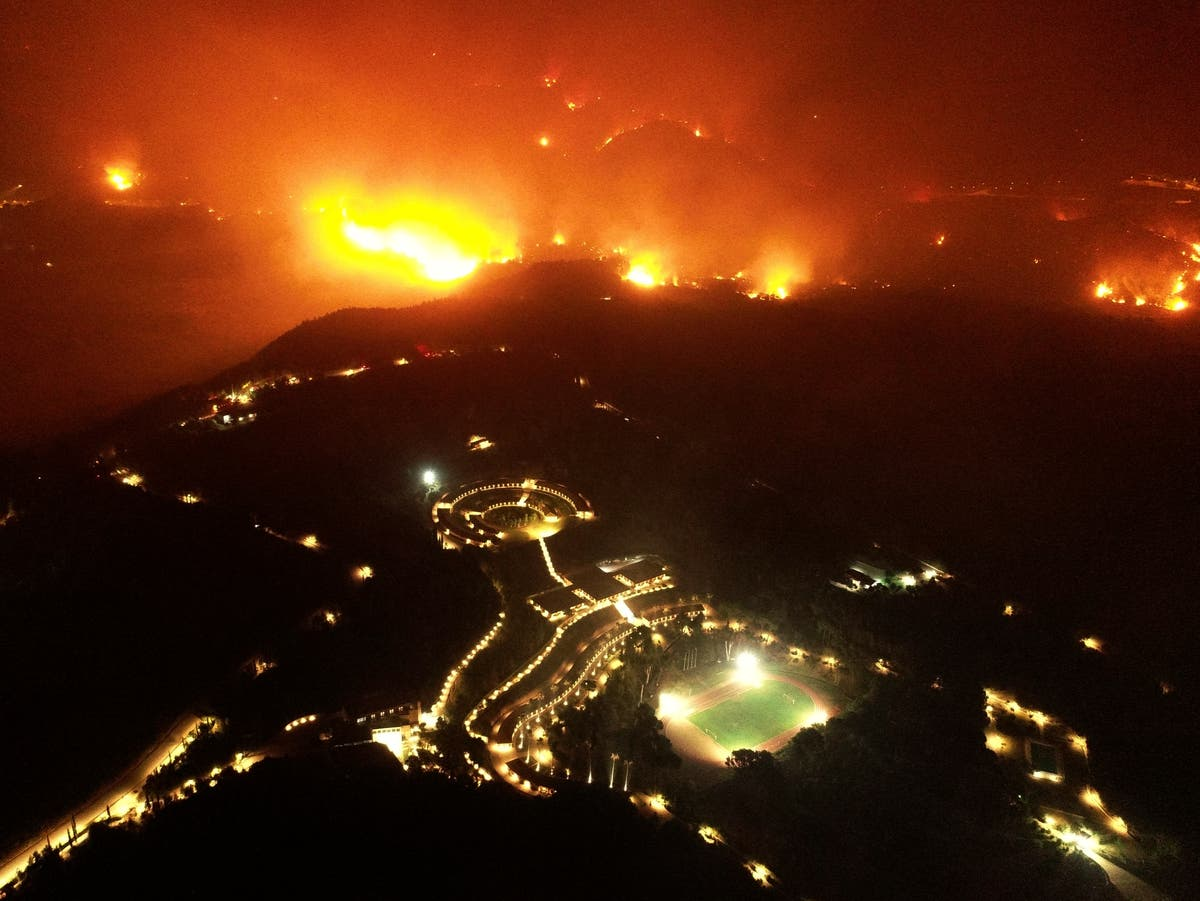 Olympia saved from wildfires and monks refuse to leave burning island – follow live