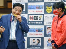 Japanese mayor faces backlash for biting on Olympic athlete's gold medal