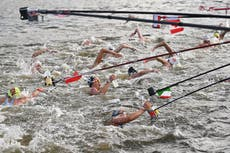 Olympic viewers amazed at how marathon swimmers get drinks during race