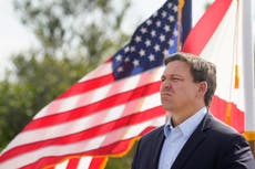 Florida governor feuds with White House as COVID cases rise