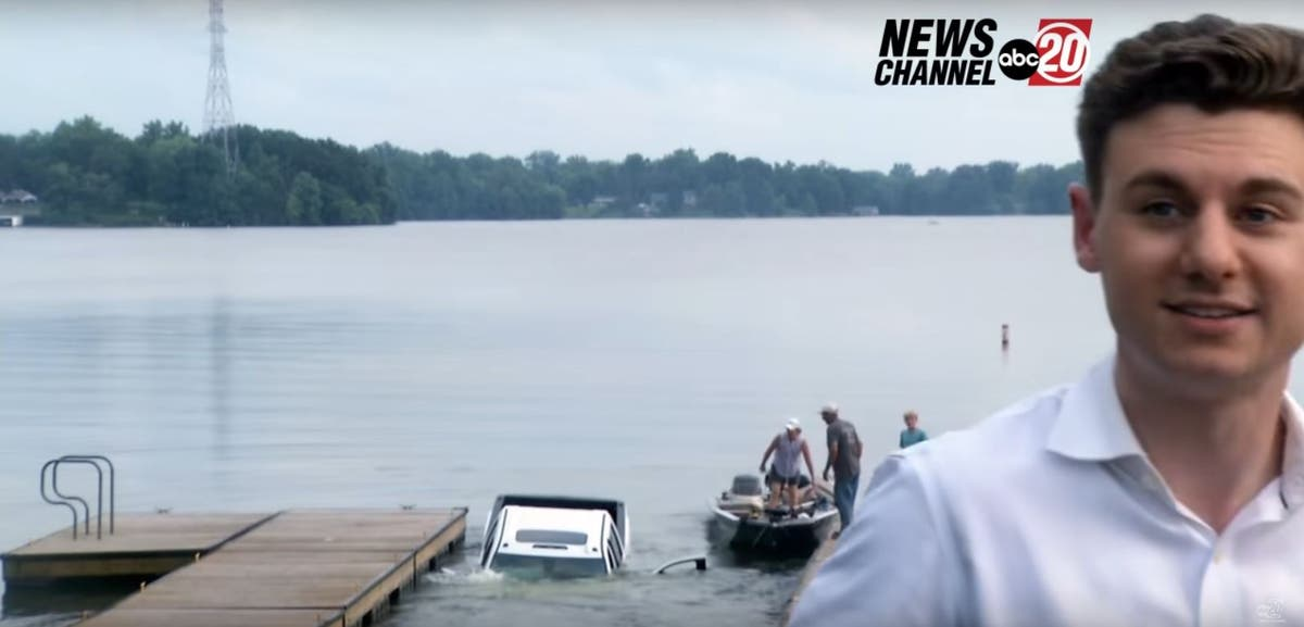 TV reporter's live piece to camera interrupted by pickup truck sinking into lake behind him
