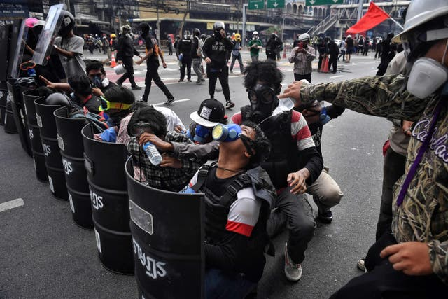 Pro-democracy protesters clash with police during a demonstration demanding Thai prime minister Prayut Chan-Ochas and King Maha Vajiralongkorn be held accountable for the governments failure to contain the Covid-19 outbreak, in Bangkok