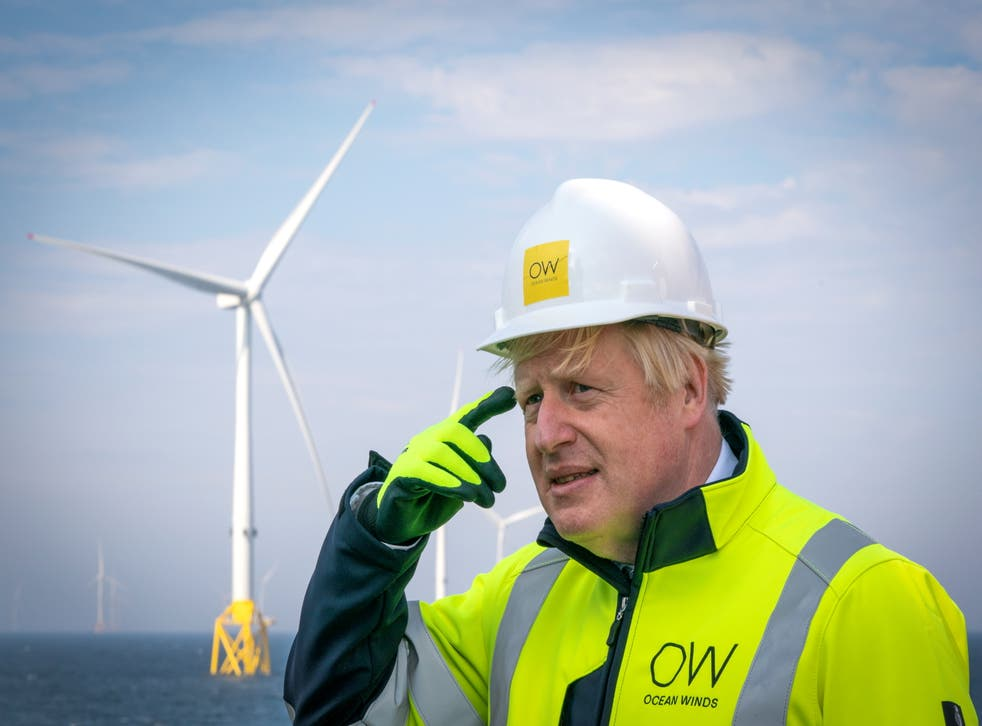 <p>Johnson says the UK must shift to clean energy sources</p>