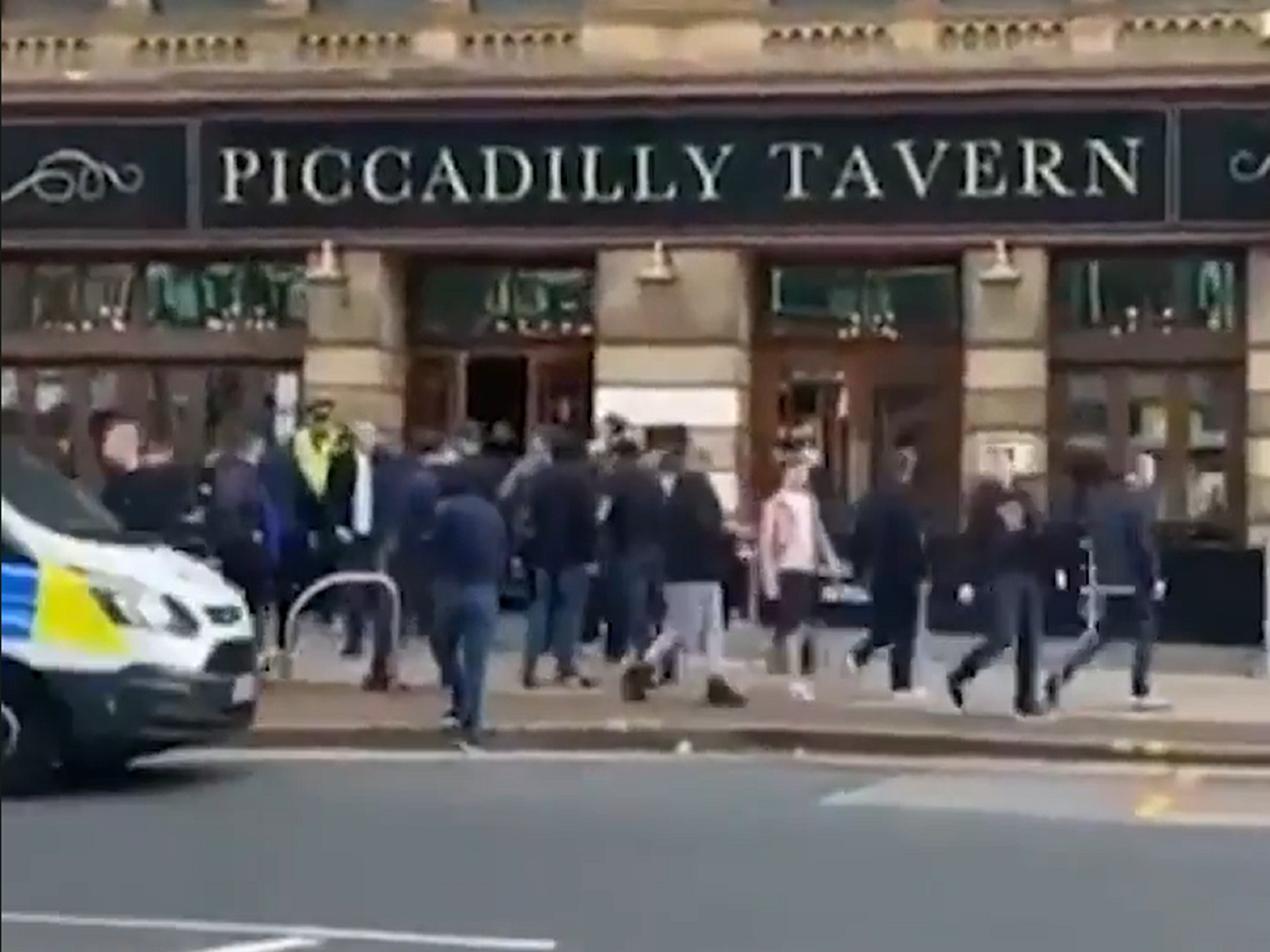Manchester United and Leeds fans clash in street brawl
