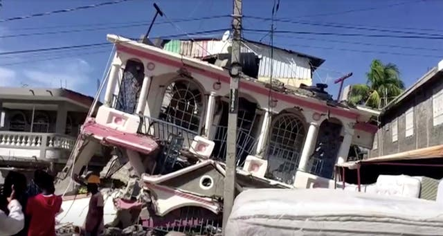 A collapsed building is seen in Les Cayes, Haiti following a 7.2 magnitude earthquake which left at least 29 people dead