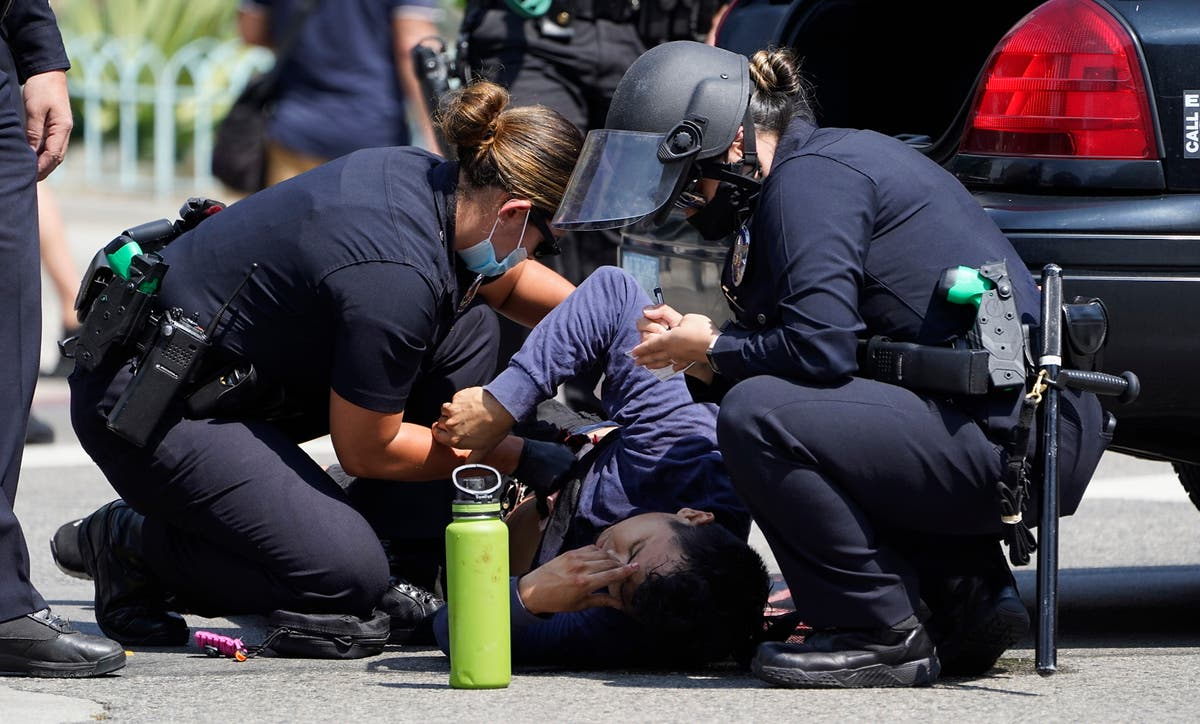 Man stabbed at LA anti-vaccination protest leaves hospital
