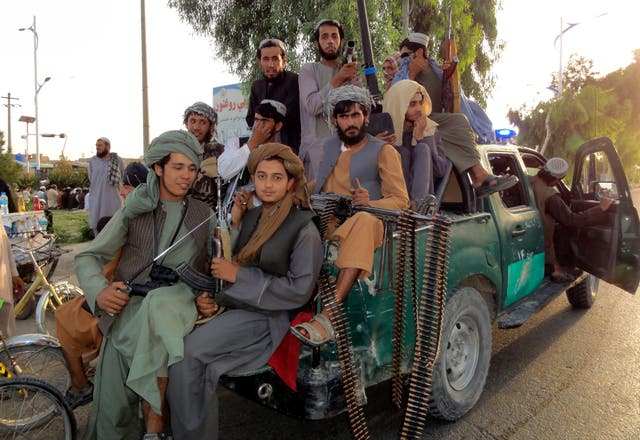 Taliban fighters patrol inside the city of Kandahar province in southwest Afghanistan