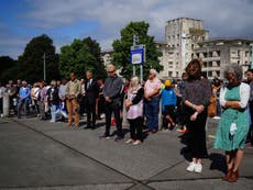 Plymouth shooting: City holds minute's silence as tributes paid to victims