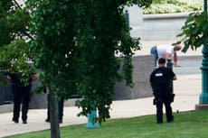 Capitol bomb threat: Suspect in police custody after hours-long standoff and demand to speak with Biden