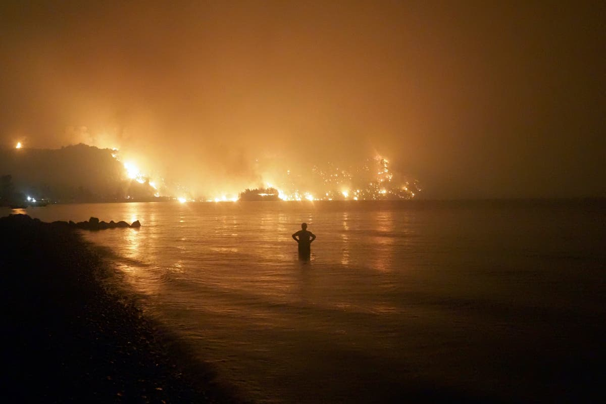 AP PHOTOS: Wildfires grow worldwide as climate sizzles