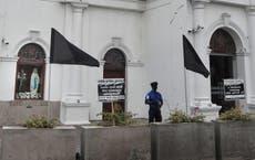 With black flags, Sri Lanka Christians protest bombing probe