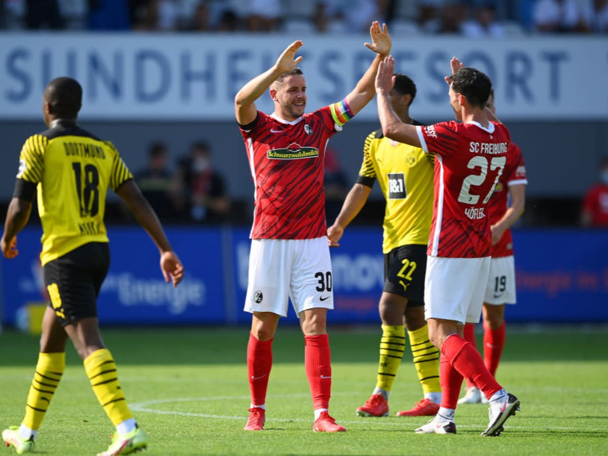 Borussia Dortmund beaten by Freiburg as Wolfsburg go top of Bundesliga
