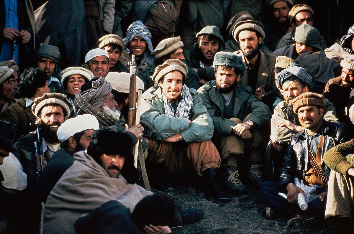 Some Afghans vow to resist Taliban from mountain enclave
