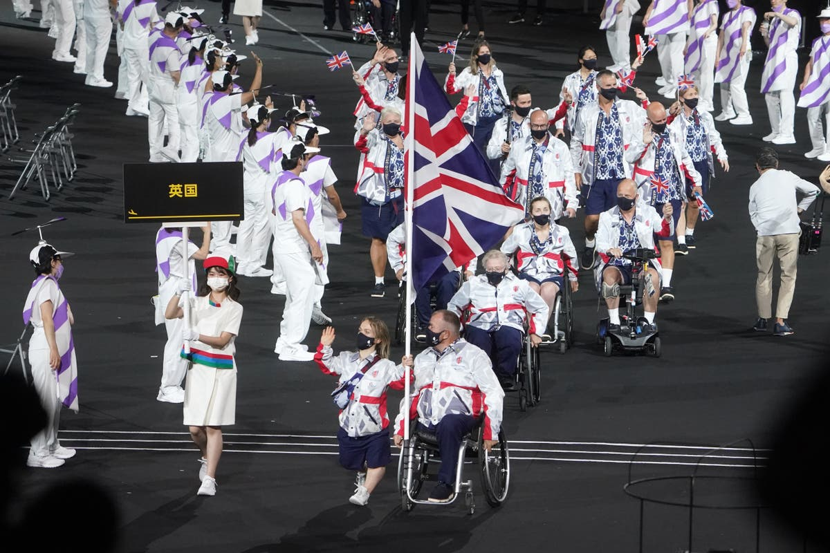 Ellie Simmonds and John Stubbs lead out British athletes at Tokyo Paralympics