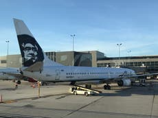 Cellphone catches fire on Alaska Airlines flight causing emergency evacuation