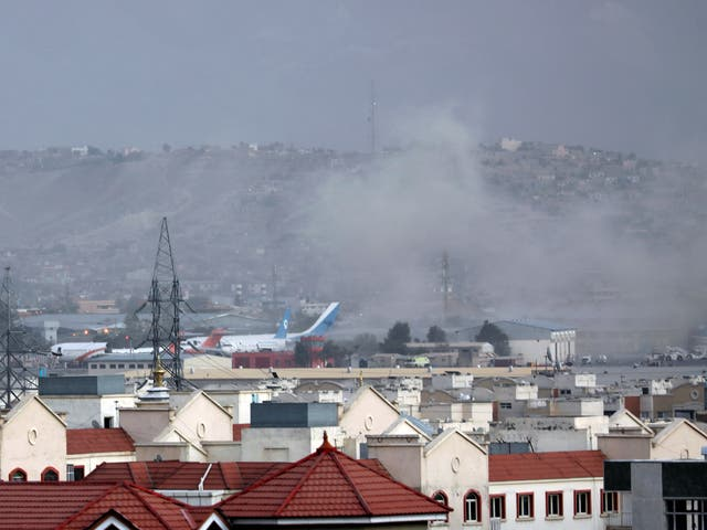Smoke rises from the site of a suspected suicide bombing outside Kabul airport in Afghanistan