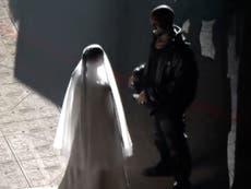 Everything we know about the wedding dress Kim Kardashian wore at Kanye's Donda event