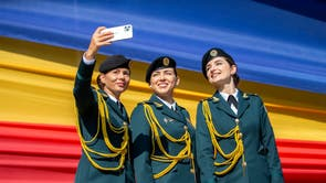 Soldiers take a selfie before a military parade in Chisinau, Moldova