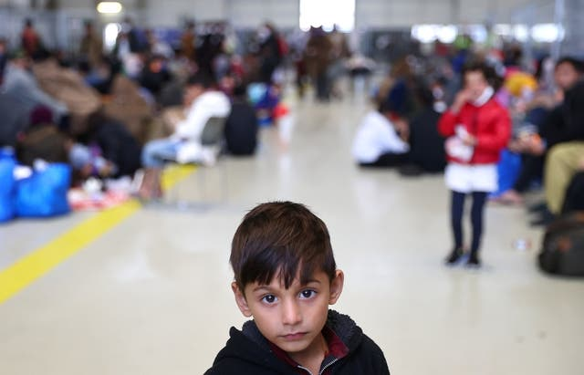 A child that was evacuated from Afghanistan looks on at the U.S. airbase in Ramstein, Germany