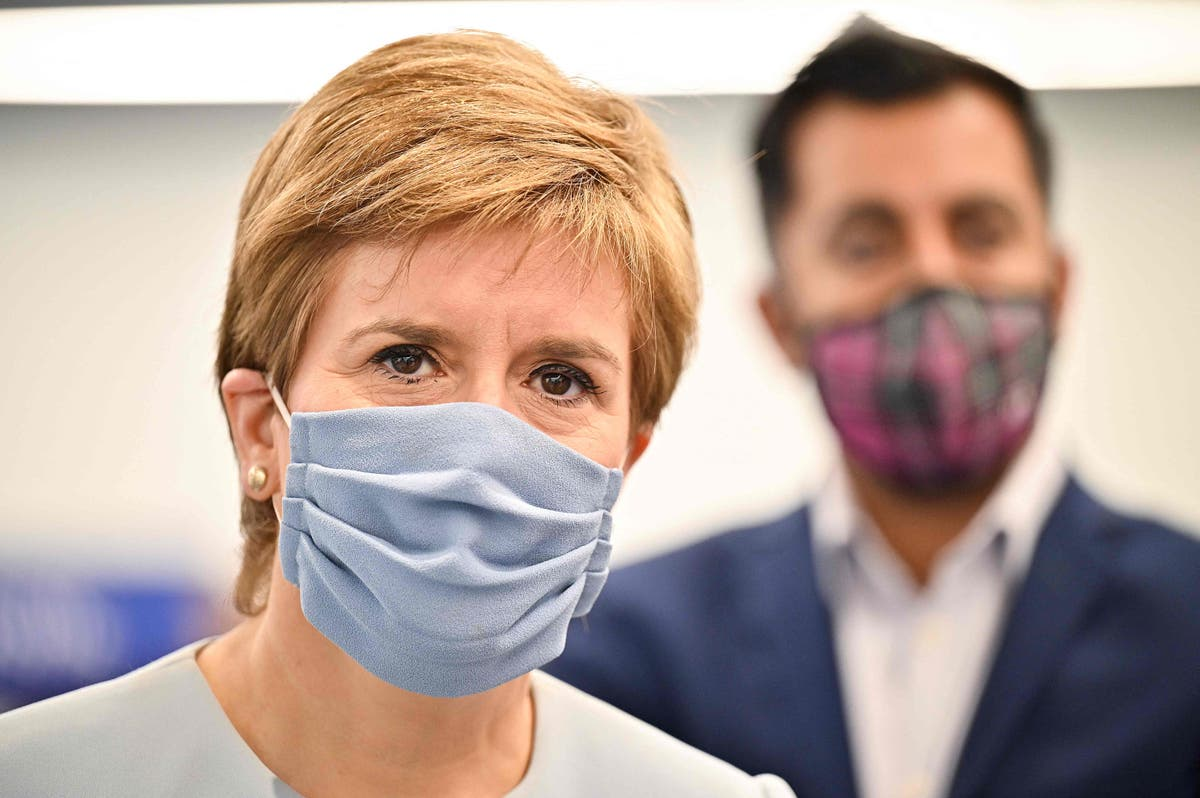 Sturgeon self-isolating after Covid 'ping' as Scotland sees record cases