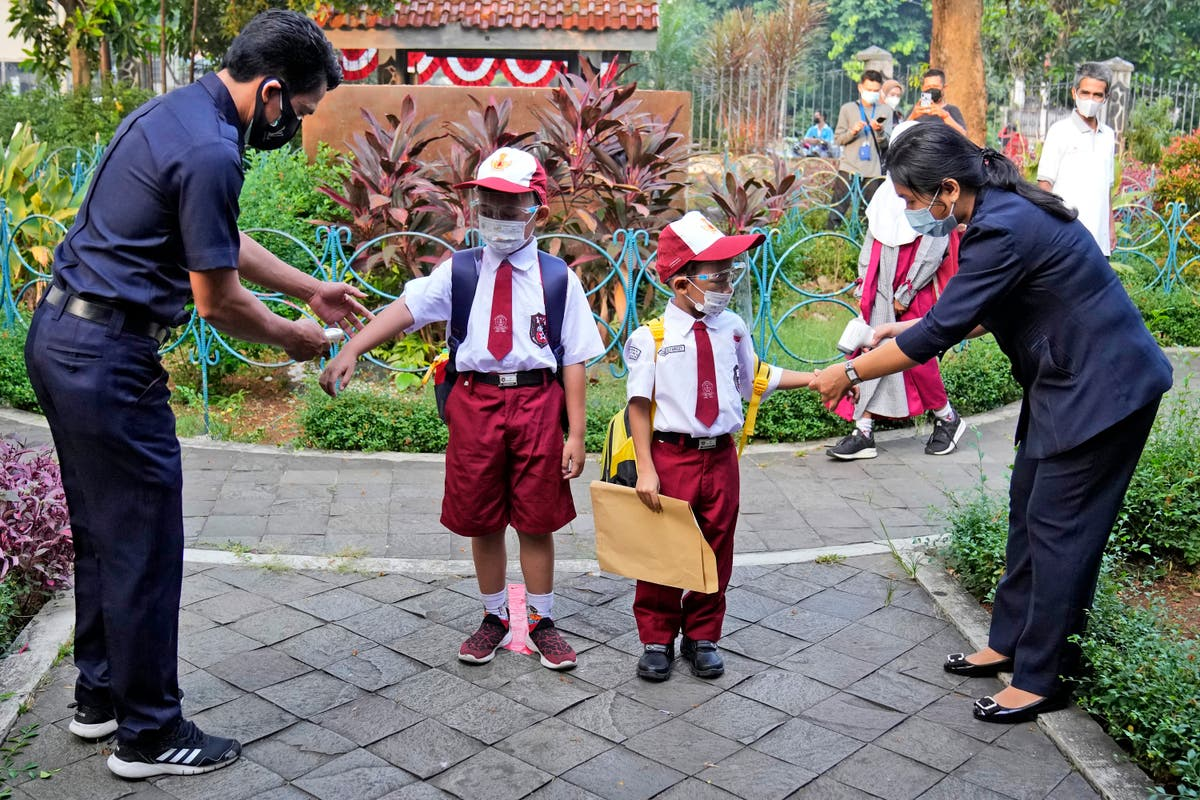 Some Indonesian students return to schools, at a distance
