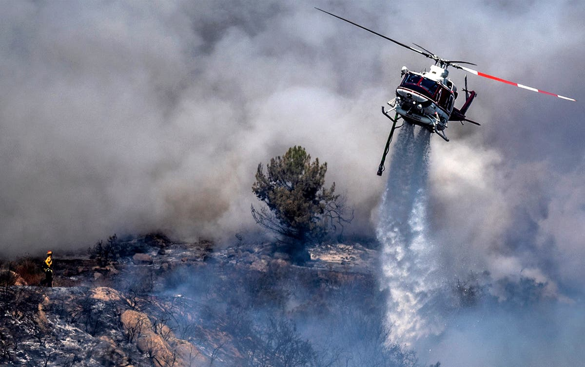 Lake Tahoe threatened by massive fire, more ordered to flee